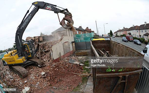 Builders begin to demolish the semidetached house at 18 Victory Road where six children died in a fire started by their parents Mick and Mairead...