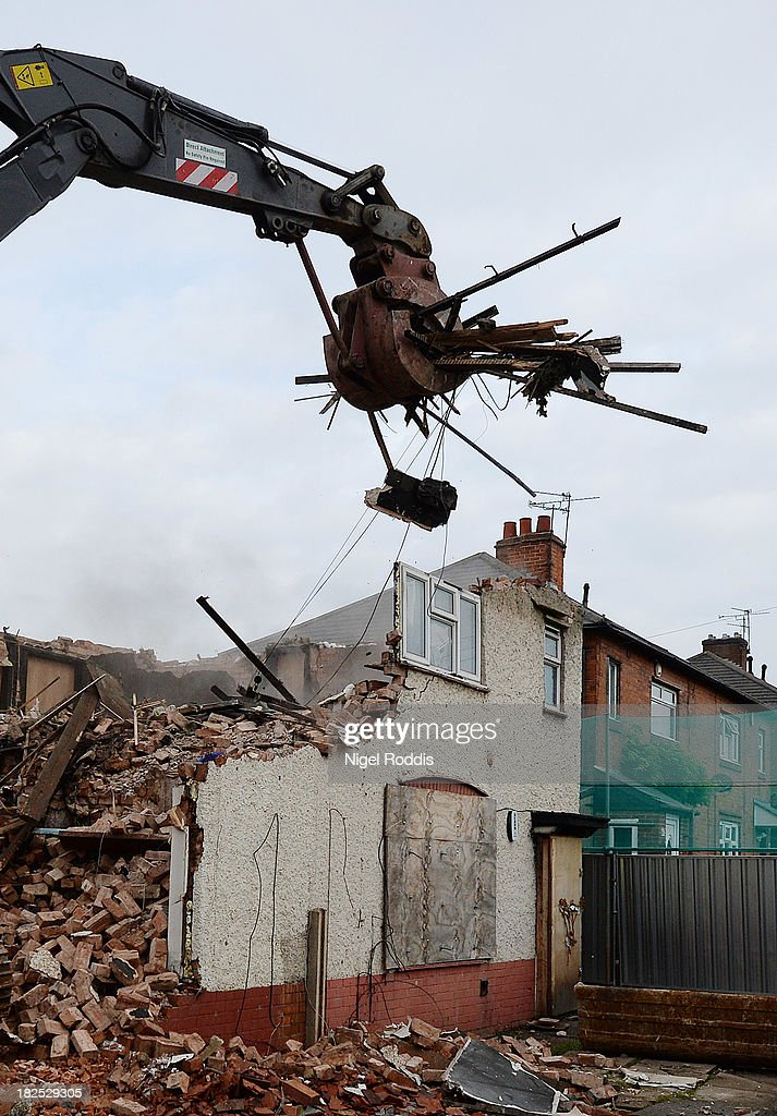 Builders begin to demolish the semi-detached house at 18 Victory Road where six children died in a fire started by their parents Mick and Mairead Philpott in Allenton on September 30, 2013 in Derby, England. The Philpotts were jailed in April, along with friend Paul Mosley, after being convicted of killing the couple's six children by setting fire to the three-bedroom semi-detached house in May 2012.