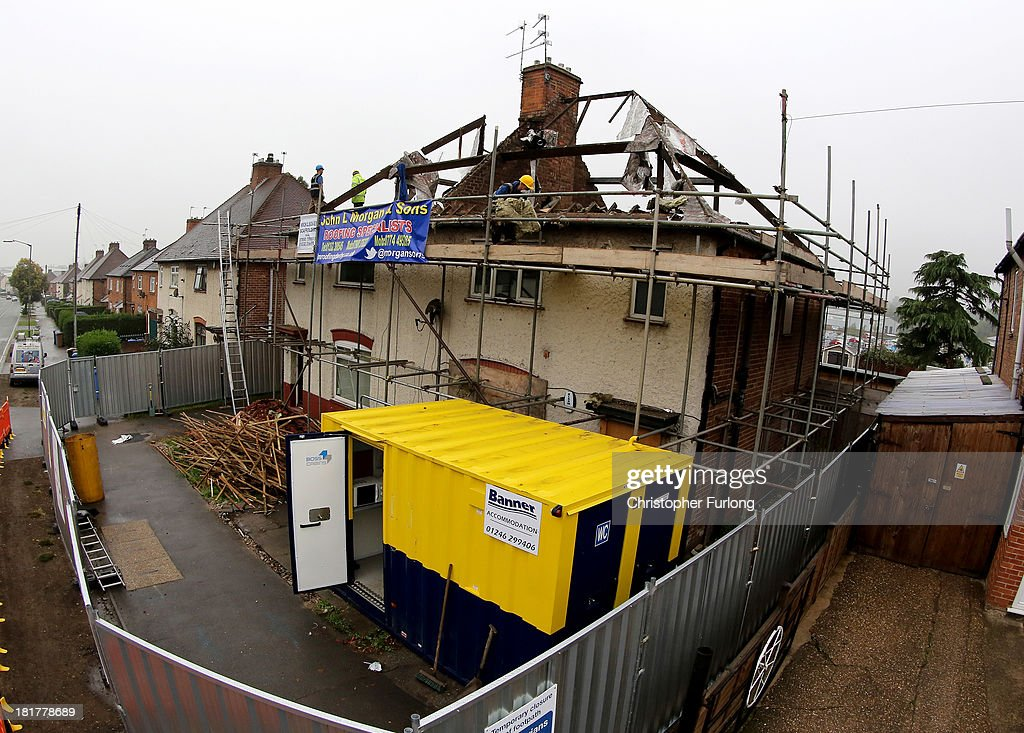 Builders begin to demolish the semi-detached house (R) where six children died in a fire started by their parents Mick and Mairead Philpott at 18 Victory Road in Allenton, Derby on September 25, 2013 in Derby, England. The Philpotts were jailed in April, along with friend Paul Mosley, after being convicted of killing the couple's six children by setting fire to the three-bedroom semi-detached house in May 2012.