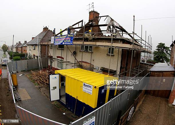 Builders begin to demolish the semidetached house where six children died in a fire started by their parents Mick and Mairead Philpott at 18 Victory...