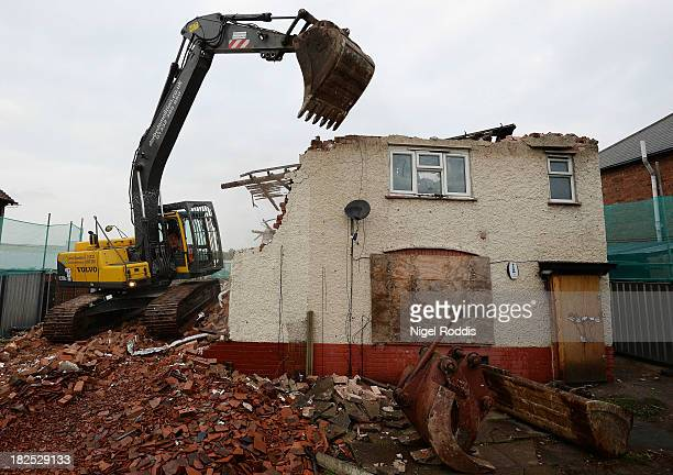 Builders begin to demolish the semidetached house where six children died in a firestarted by their parents Mick and Mairead Philpott at 18 Victory...
