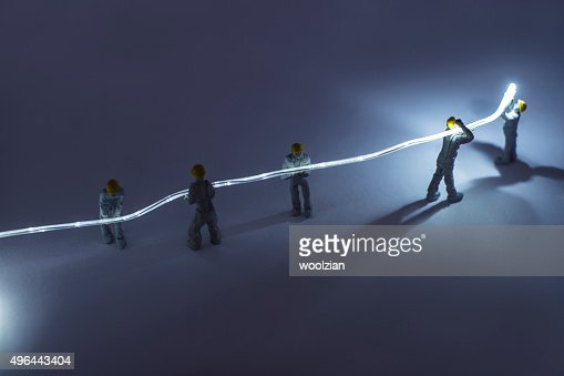 Builders installing fibre optic