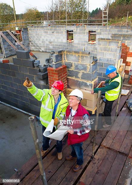 Builders Looking at Blue Prints