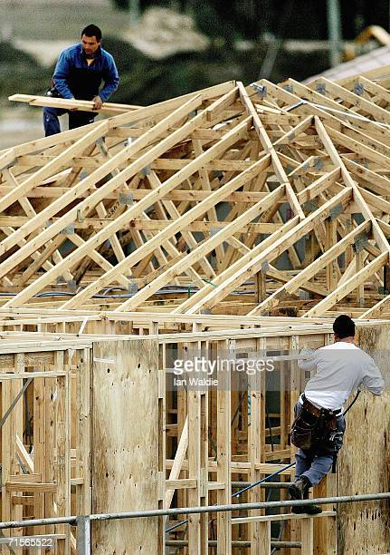 Builders work on a house under construction amongst an established suburb August 2 2006 in Sydney Australia The Reserve Bank of Australia today...