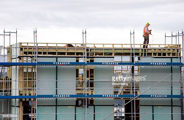 Builders work on the construction site of a high rise student housing residence at Victoria University in Wellington New Zealand on Monday July 28...