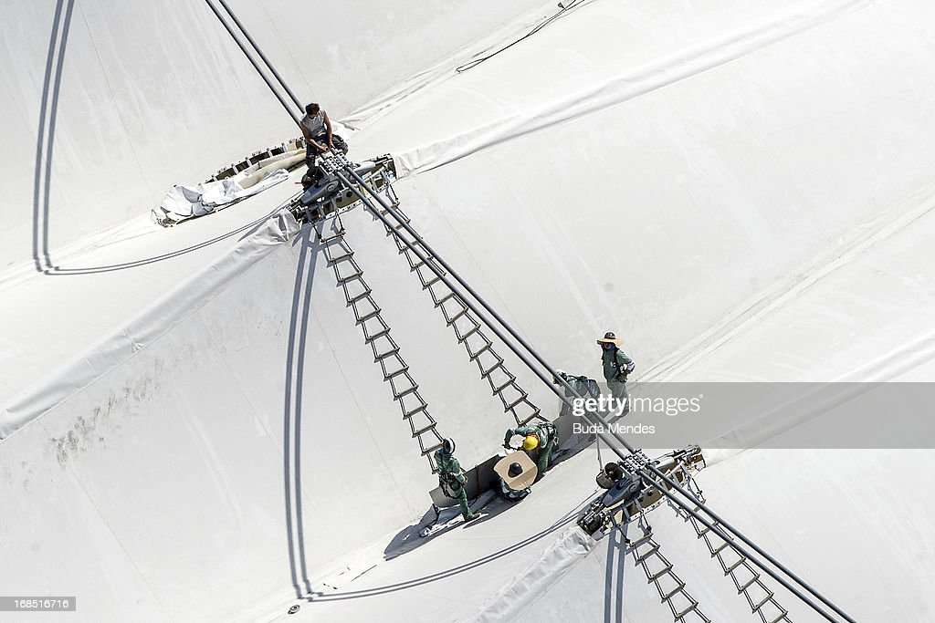 Builders work on the new roof of the Maracana Stadium which is undergoing renovations for the FIFA Brazil 2013 Confederations Cup and the FIFA Brazil 2014 World Cup on May 10, 2013 in Rio de Janeiro, Brazil.