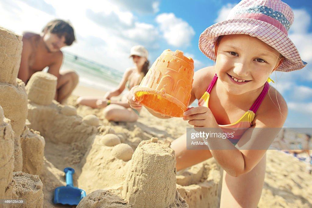 Building a sand castle : Stock Photo