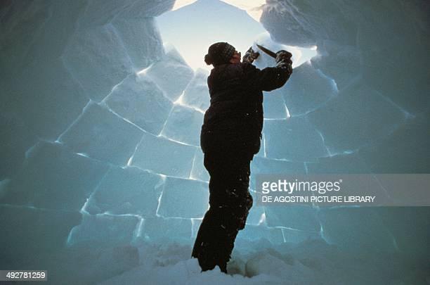 Building an igloo Baffin Island Canada