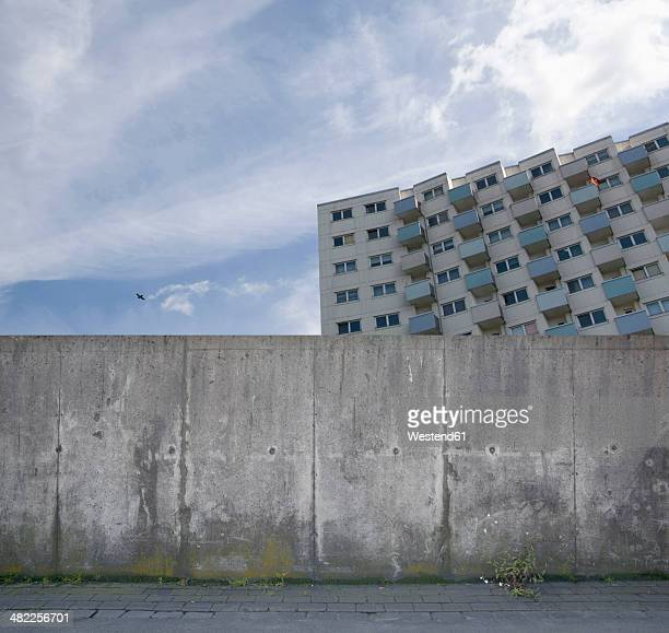 Building behind a concrete wall, composing