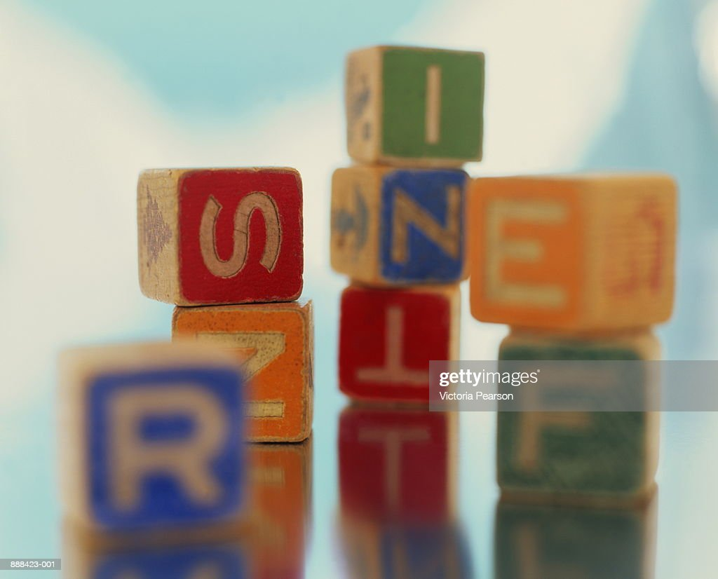 Building blocks with letters, close-up : Stock Photo