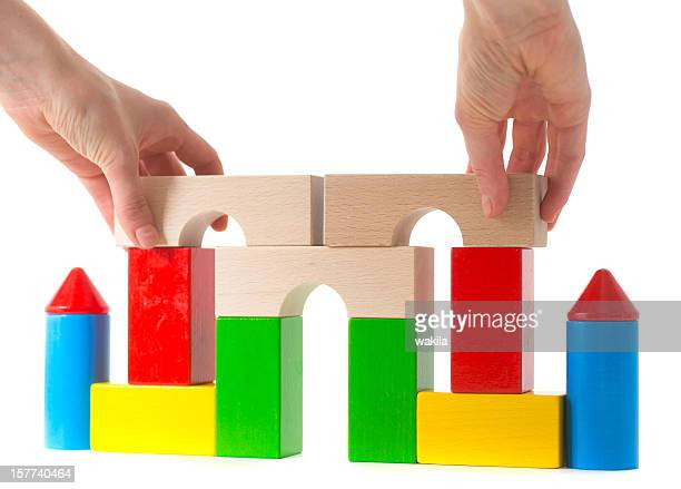 building castle with colored toy cubes