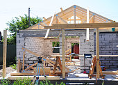 Building New House from Autoclaved Aerated Concrete Blocks with Roofing Construction. Wooden Roof Frame House Construction