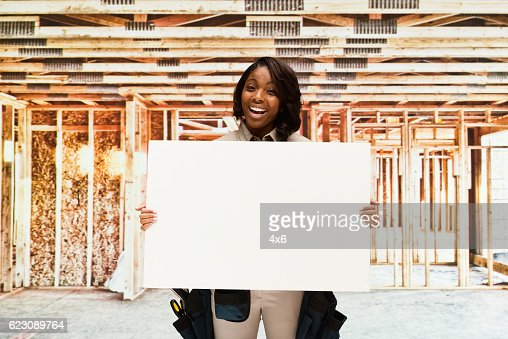 Building contractor holding placard