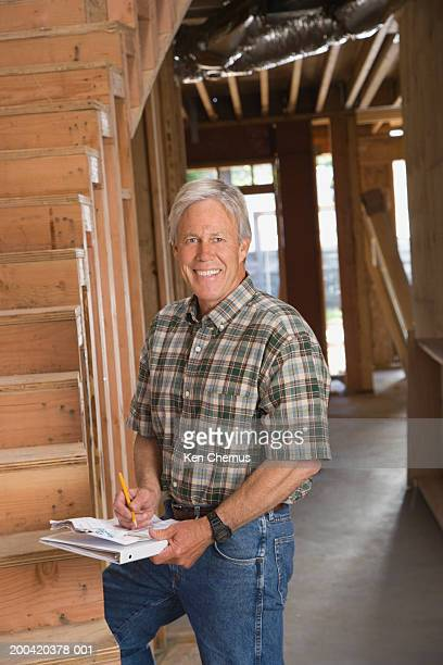 Building contractor standing at foot of stairs