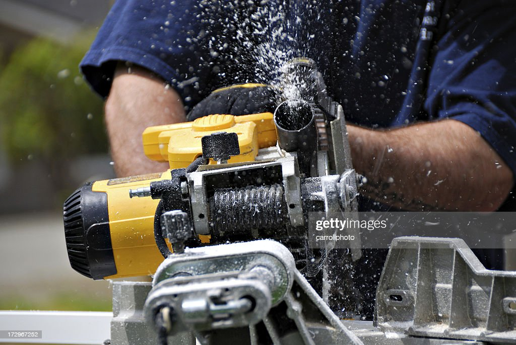 Building Contractor Using Miter Saw