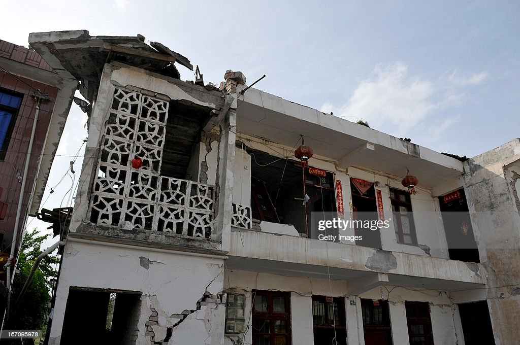 YA'AN, CHINA - APRIL 20: (CHINA OUT) A building damaged by a strong earthquake which hit China's Sichuan Province on April 20, 2013 in Ya'an, Sichuan Province of China. The devastating earthquake hit the region in the morning claiming over 100 lives and injuring thousands.