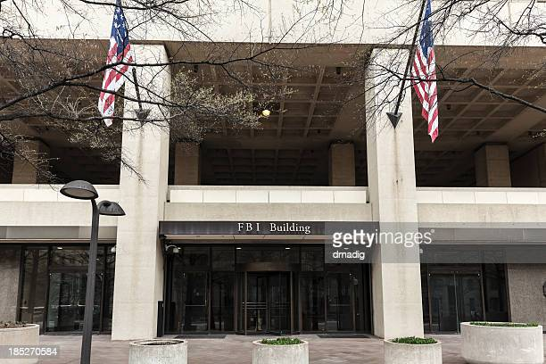 FBI Building Entrance Flanked by Flags