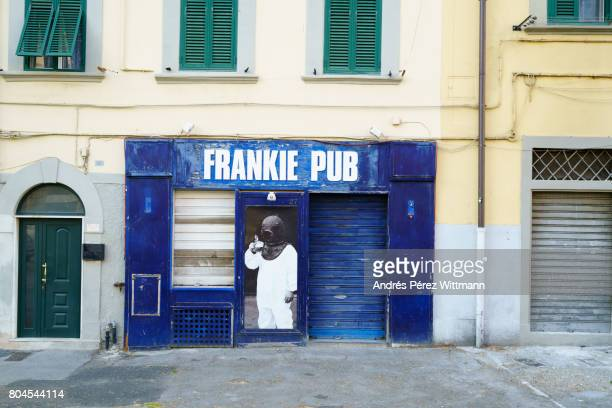 Building front with closed pub in Livorno, Italy
