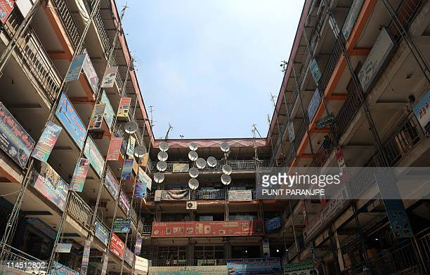 A building hosting electronics appliance stores is seen in a market in Kabul city on May 23 2011 A suicide bomber struck a crowded Afghan bazaar on...
