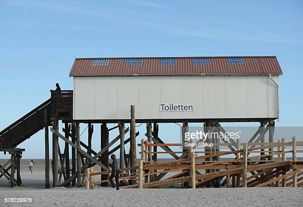 A building housing public toilets stands on stilts at the beach on July 18 2016 at SanktPeterOrding Germany SanktPeterOrding is among the top...