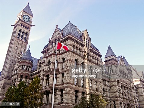 A building in Toronto with the Canadian flag out front