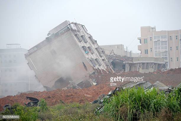 A building is damaged after a landslide hit an industrial park in Shenzhen south China's Guangdong province on December 20 2015 A massive landslide...