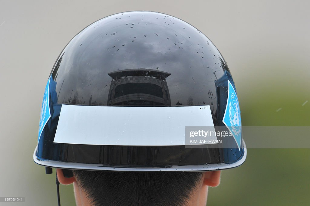 A building is reflected on the helmet of a South Korean soldier on guard at the truce village of Panmunjom in the demilitarised zone on April 23, 2013. Tensions simmer along the world's last Cold War frontier after weeks of hostile threats from North Korea and its preparations for potential missile launches.