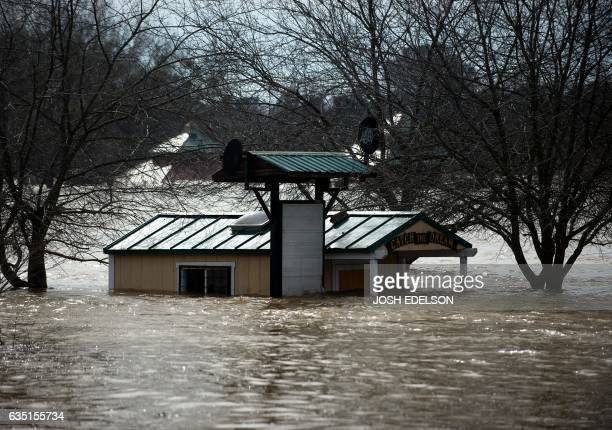 A building is seen submerged in flowing water at Riverbend Park as the Oroville Dam releases water down the spillway as an emergency measure in...