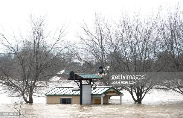 A building is seen submerged in flowing water at Riverbend Park as the Oroville Dam releases water down the spillway in an emergency measure in...