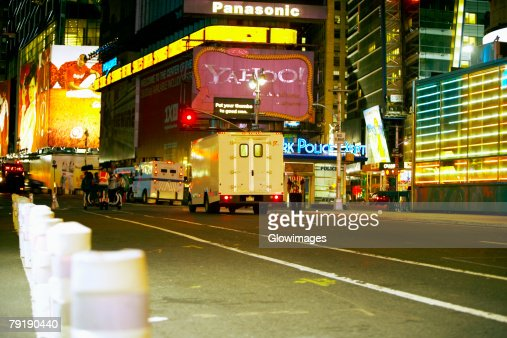 Building lit up at night in a city, Times Square, Manhattan, New York City, New York State, USA : Foto de stock