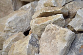 Building material stone. The light stone is straightened in a pile