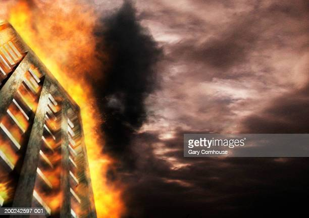 Building on fire, low angle view (digital composite)