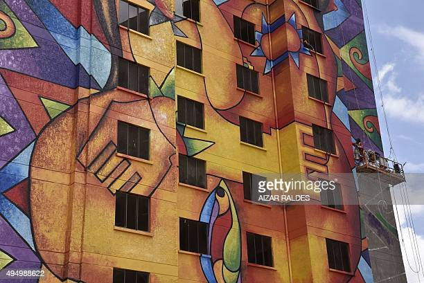 A building painted with Andean motifs in El Alto 12km from La Paz on October 29 2015 Bolivian watercolourist Roberto Mamani is painting seven...