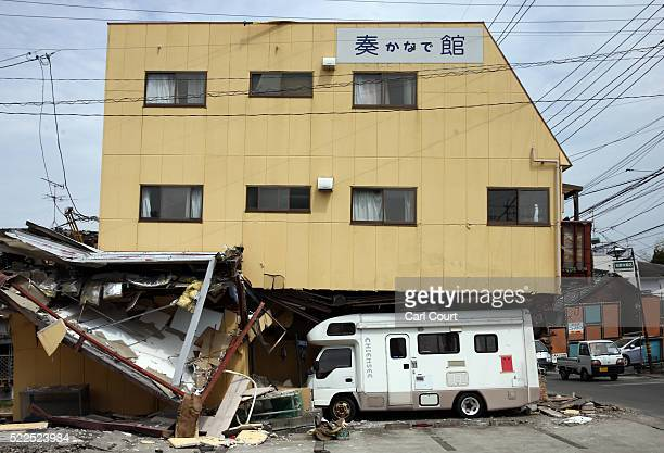 A building partially rests on a camper van following an earthquake on April 20 2016 in Mashiki near Kumamoto Japan As of April 20 48 people were...