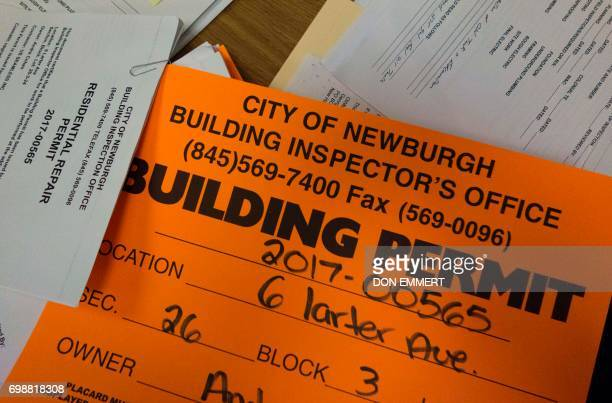 Building permits sit on a desk in the office of Newburgh New York Assistant Fire Chief William Horton on May 30 2017 Rows of boardedup homes became a...
