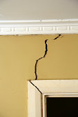 Cracks appearing in an interior wall.