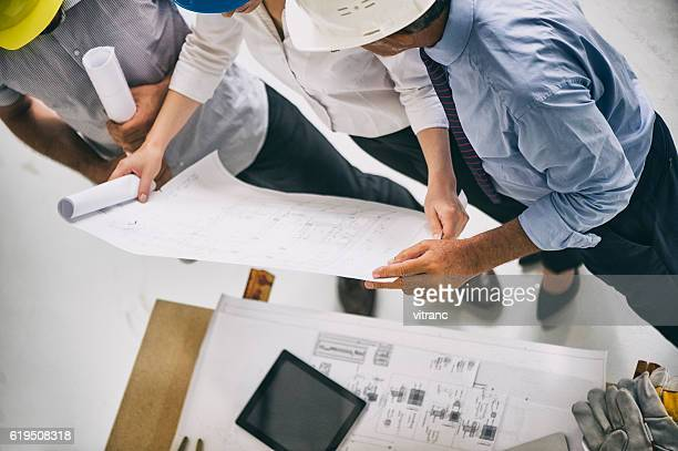 Building professionals meeting on site