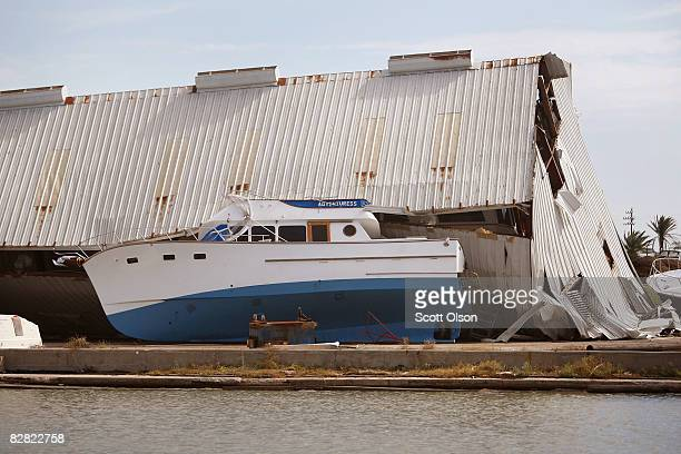 A building rests on a boat following Hurricane Ike September 15 2008 in Galveston Texas Although search and rescue efforts continue on the island...