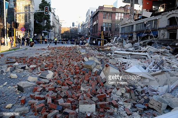 Building rubble is strewn across the street from damaged buildings in the city centre after a 71 magnitude earthquake struck 30km west of...