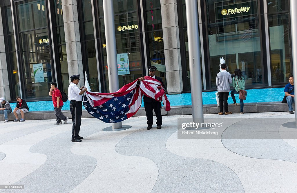Building security employees lower the American flag near Rockefeller Center September 16, 2013 in the Manhattan borough of New York.