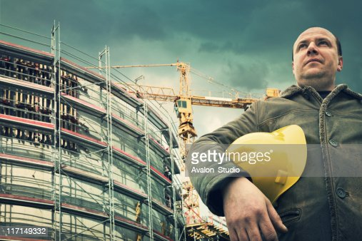 Building site and worker : Stock Photo