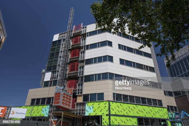 A building stands under construction in downtown Sacramento California US on Tuesday June 6 2017 As the cost of daily life tests the bounds of...