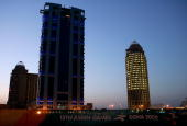 A building stands under construction in the early morning hours during the 15th Asian Games Doha 2006 November 29 2006 in Doha Qatar