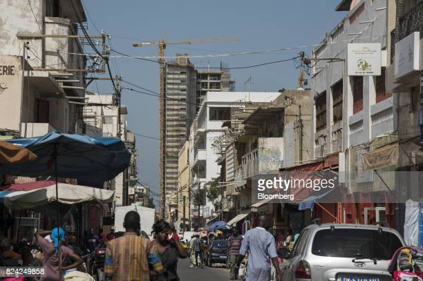 A building under construction stands behind the Sandaga market in the Plateau district of Dakar Senegal on Friday July 28 2017 Senegalese voters will...