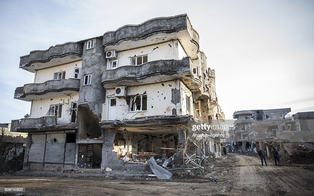 A building which was damaged by PKK terrorists is seen as Turkish security forces patrol around, after counter-terror operation in Cizre, the southeastern Turkish town that has seen fighting rage between security forces and PKK terrorists finished, on February 12, 2016.