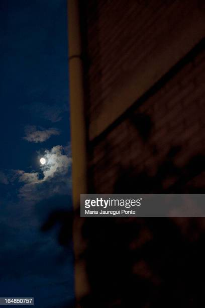 A building with the moon in the night sky