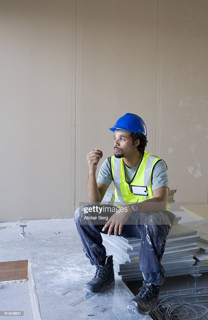 Building worker eating apple : Stock Photo