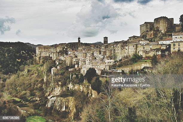 Buildings Against Cloudy Sky At Sorano