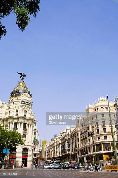 Buildings along a road in a city, Metropolis Building, Madrid, Spain