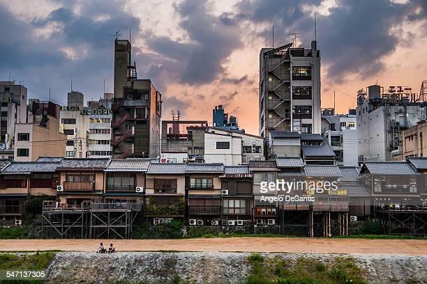 Buildings along Kyoto's Kamo river in setting sun